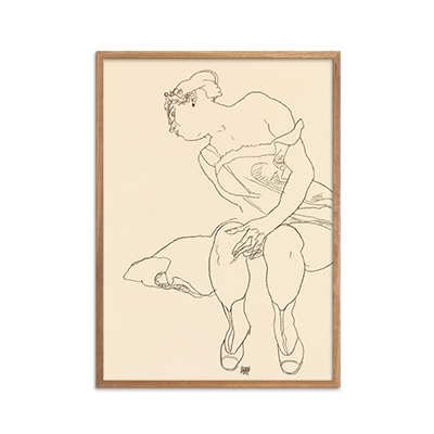 Seated Woman in Corset and Boots